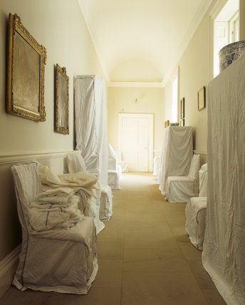 Dust sheets cover the furniture in the Stone Corridor