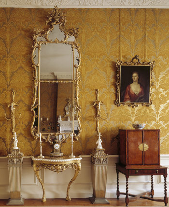 A detailed close up of a mirror and side table, plus cabinet found in the Drawing Room