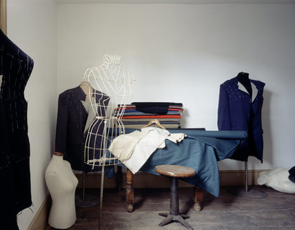 An upstairs room in the Tailor's Shop in the Birmingham Back to Backs showing Dummies, rolls of cloth and unfinished suits