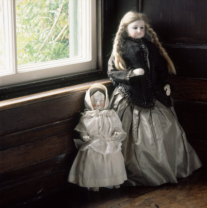 (FL) Shown on the window ledge in the bedroom at Hill Top are two French dolls which Beatrix said had belonged to her as a child although 'the shot silk dress is older'