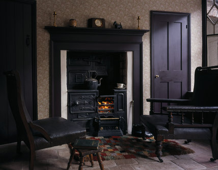 The Fireside In The Living Room Of The 1930s House Showing