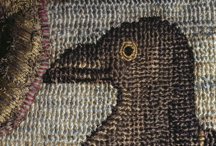 Detail of a bird's head on the Marian Needlework at Oxburgh Hall