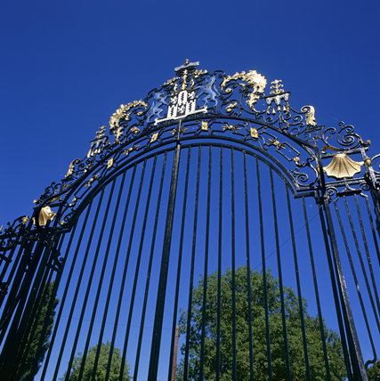 Close-up of the gates at Hatchlands, showing the highly decorated gold painted iron work round the archway