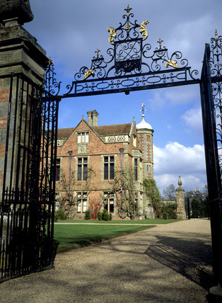 Charlecote Park, a Tudor house in Warwickshire, from the south-east - view through the gate