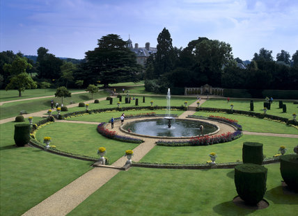 View of the Italian Garden at Belton House seen from the orangery showing the layout of a round pond within a square of lawns with topiary divided into quadrants