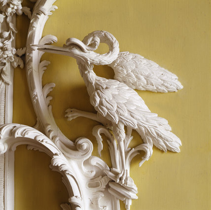 Detail of carved crane or heron at bottom corner of wall niche in the North Hall at Claydon House