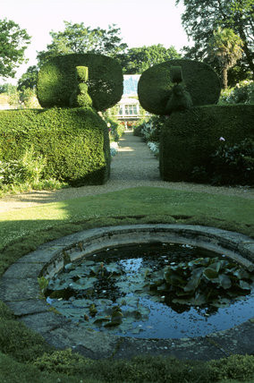 The pool garden at Peckover House looking towards the Orangery between clipped box hedges