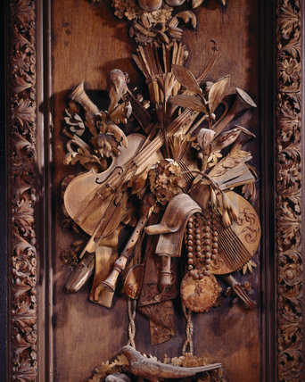 The limewood carving of musical instruments by Grinling Gibbons, situated on the east wall of the Carved Room at Petworth