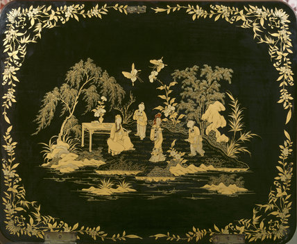 Close-up of a top of a needlework cabinet, showing a Chinese scene