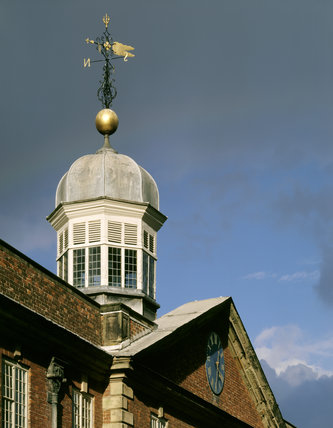 Cupola and iron weathervane on top of the stable block at Calke Abbey built in 1712-14 for Sir John Harpur by William Gilks