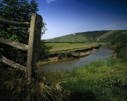 The Cuckmere River flowing through Frog Firle Farm