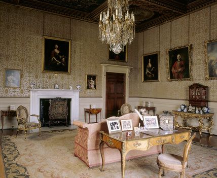 The Drawing Room at Chirk Castle showing the writing table, chimneypiece, chandelier and settee