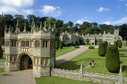 View of the 17th century gatehouse and Lanhydrock house showing the courtyard and topiary