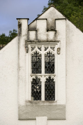 Oriel window with nineteenth-century castellations on the east front of Bradley Manor, a medieval manor house at Newton Abbot, Devon