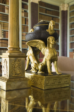 Egyptian porphyry and ormolu urn in the style of Louis XVI, in the Library at Hinton Ampner, Hampshire