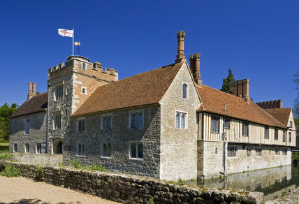 The Gatehouse Tower and West front to the left of the picture and the South Front at Ightham Mote, Sevenoaks, Kent, a fourteenth-century moated manor house