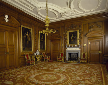 The Saloon, a magnificent formal reception room with polished panelling and pedimented doorcases