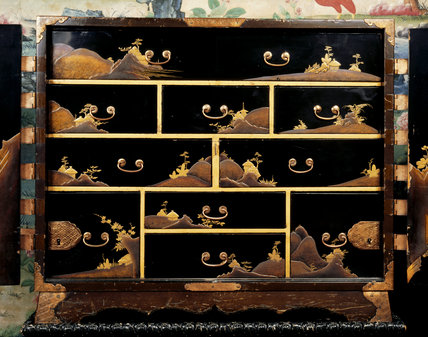 Close view of the drawers inside the late C17th black Japanese lacquer cabinet at Penrhyn Castle