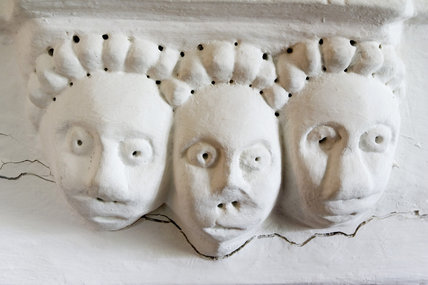 Plasterwork faces on the fireplace in the Corner Bedroom at Westwood Manor, near Bradford-on-Avon, Wiltshire
