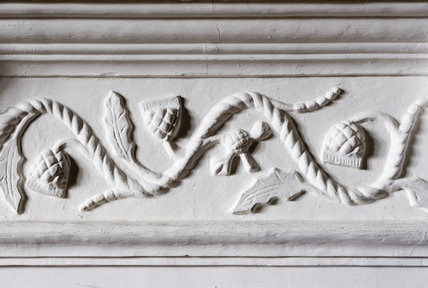 Jacobean plasterwork frieze on the fireplace in the Kings Room, featuring a thistle motif, at Westwood Manor, near Bradford-on-Avon, Wiltshire
