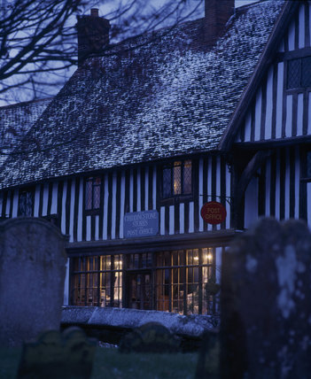 A snowy evening view of the Post Office at Chiddingstone in Kent