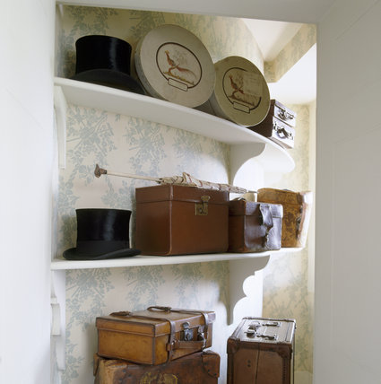 The Corner Dressing Room at Berrington Hall showing a partial view of a cupboard containing items belonging to the gentleman of the house