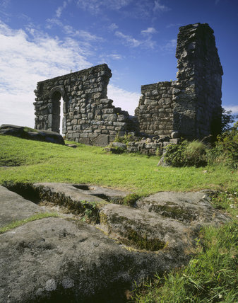 The ruins of St. Patrick's Chapel (romanesque) at Heysham Head on the wild coastal heathland of Morecombe Bay.