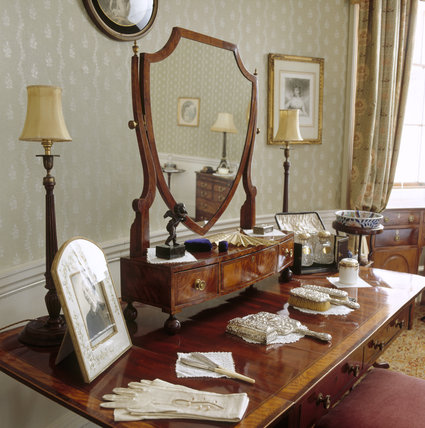 The Oval Bedroom at Berrington Hall showing a partial view of the dressing table featuring items belonging to Lady Digby and to the donor, Mrs