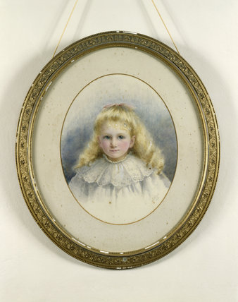 Close view of a painted portrait of Gwladys Lewes (little girl wearing a white smock with a lace collar) in a carved oval frame, by Eugene Verboekhoven in the Drawing Room at Llanerchaeron