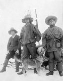 Three expedition members and sledge