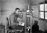 Dr Simpson at work in the Magnetic Hut at Winterquarters. January 5th 1911