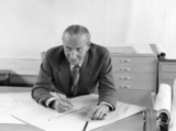 Alec Issigonis 1959 at his drawing board in his Longbridge offic