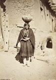 Zuni woman carrying a pottery vessel