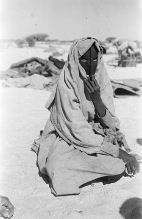 Harasis woman with a mask