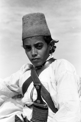 Arab boy wearing a conical hat