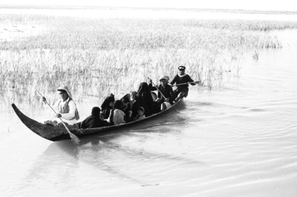 Madan people in a boat in the Marshes