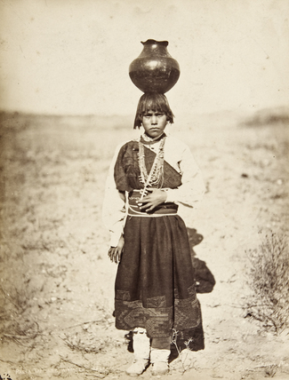 Pabla Tafolla carrying a pottery vessel