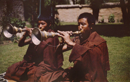 Monks blowing trumpets
