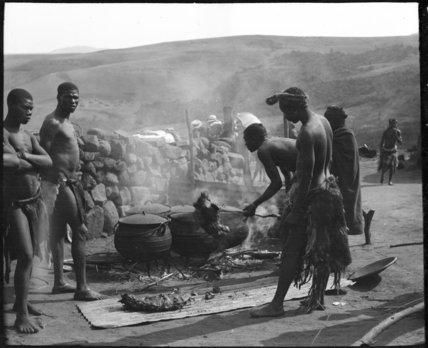Zulu men cooking meat