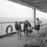 Children playing on CANBERRA's deck