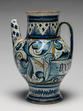 Maiolica spouted pharmacy jar with a scroll