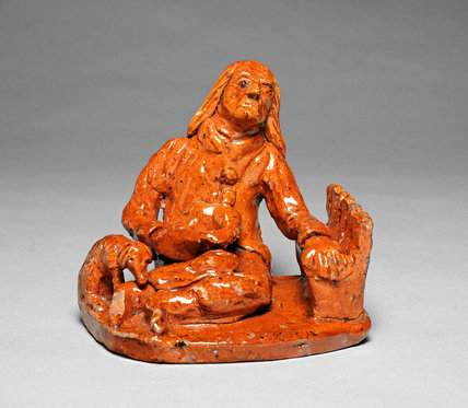 Figure of a Seated Beggar, English