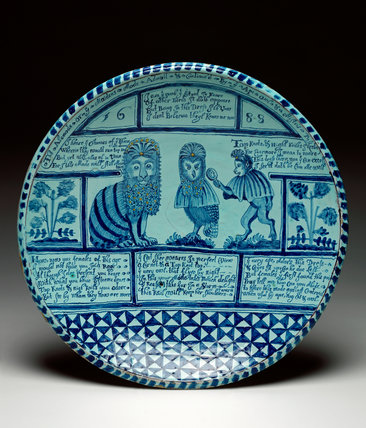 English Delftware charger with a cat, an owl and a monkey