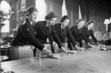 WRNS stewards laying the table in the mess at the Royal Naval College, Greenwich, 1942.
