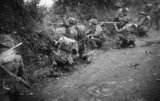 Infantry of the 6th Royal Scots Fusiliers, 15th (Scottish) Division, in action in a sunken lane during Operation 'Epsom', Normandy, 26 June 1944.