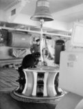 Tiddles', the ship's cat of HMS VICTORIOUS, at his favourite station on the after capstan, 10 July 1942.
