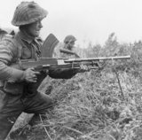 A Bren gunner of the 8th Royal Scots at Moostdijk, Holland, 6 November 1944.