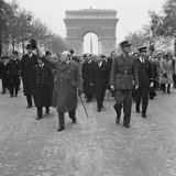 Winston Churchill and General Charles de Gaulle walk down the Avenue des Champs-Elysee duirng the French Armistice Day parade in Paris, 11 November 1944.