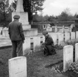 Soldiers inspect graves at the South African First World War cemetery at Delville Wood, 13 November 1944.