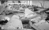 A hangar full of wrecked German aircraft at Schmarbeck airfield, Germany, 20 April 1945. In the foreground are Heinkel He 111 and He 177 bombers.